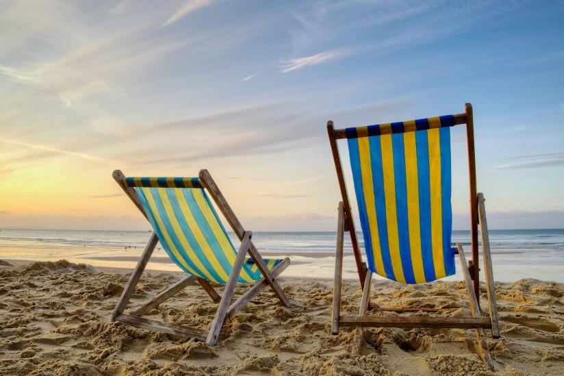 Beach chairs during sunrise