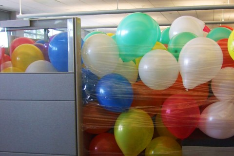 Cubicle filled with balloons