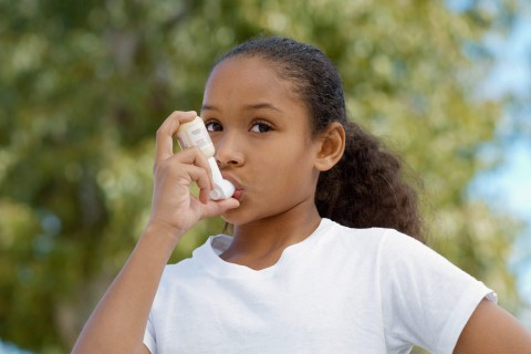 child with inhaler