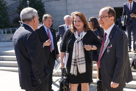 Trustee Lisa Barkett and USC President C. L. Max Nikias chat on Capitol Hill