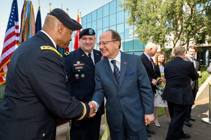 President Nikias shakes hands with Lt. Gen. Larry Wyche