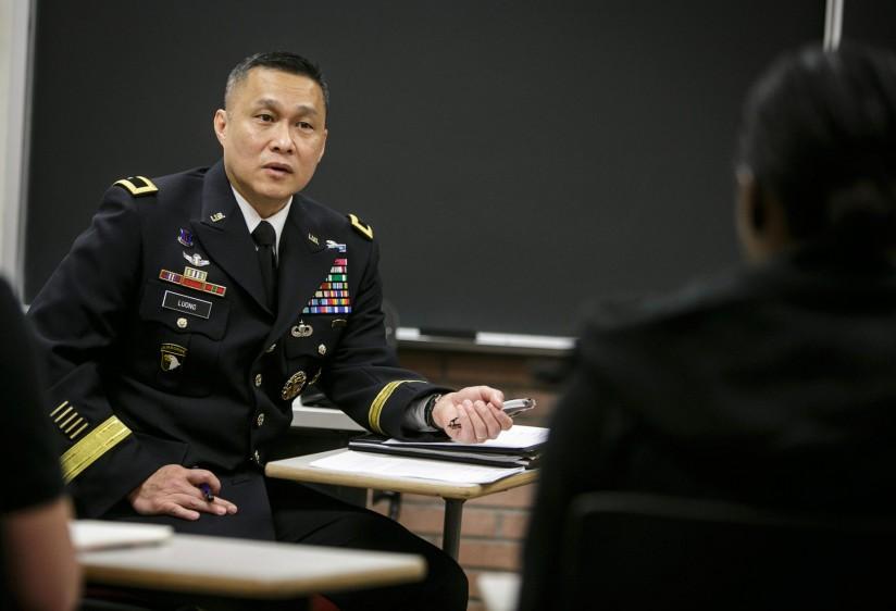 Viet Luong listens to a cadet.