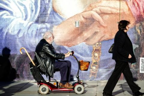Man riding electric convenience vehicle