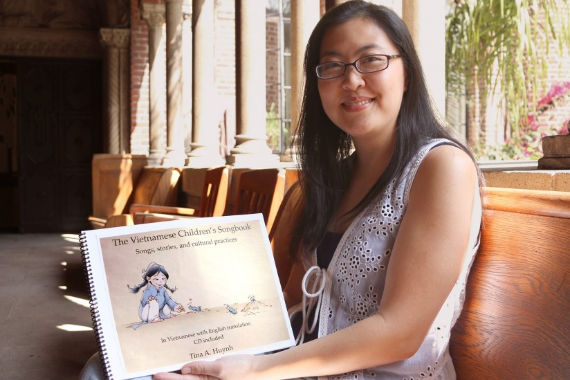 Tina Huynh with her book