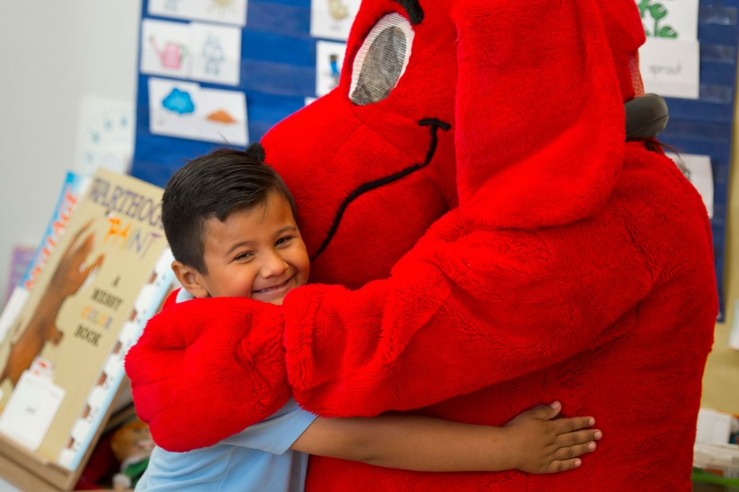 Clifford hugs student