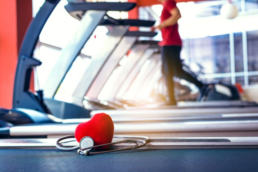 plush heart and stethoscope on treadmill