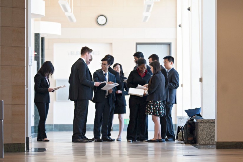 Students study in courtroom hallway