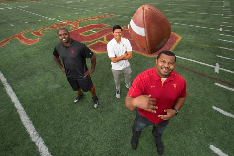 Three football coaches