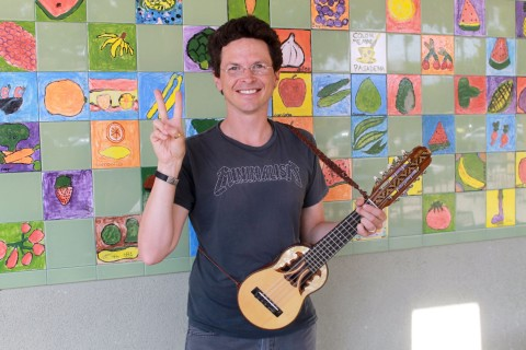 Nils de Mol Van Otterloo poses with guitar