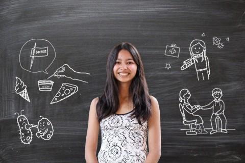 Nina in front of chalkboard
