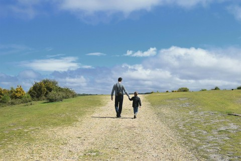Father and young son walking
