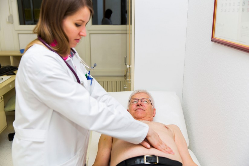 Man having abdominal exam