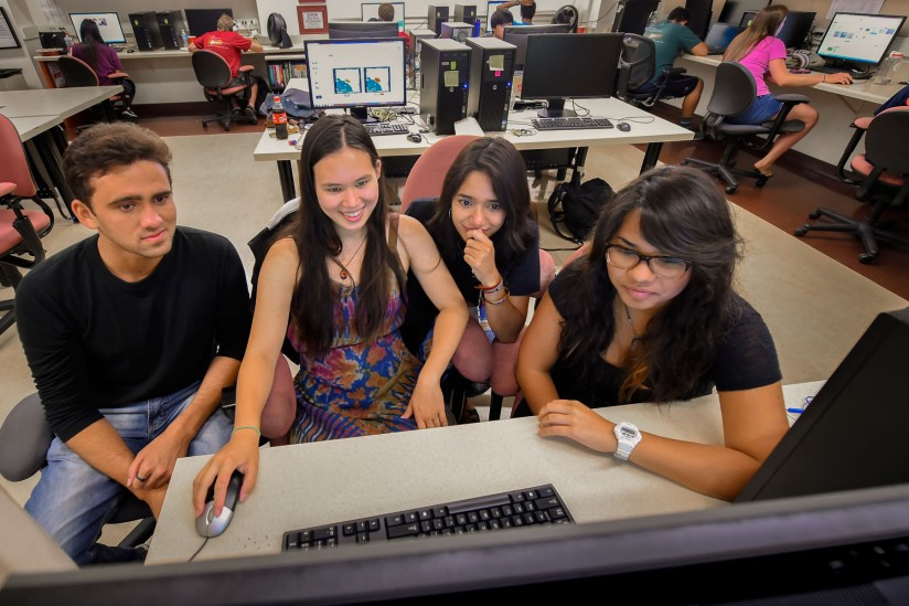 students working on computer