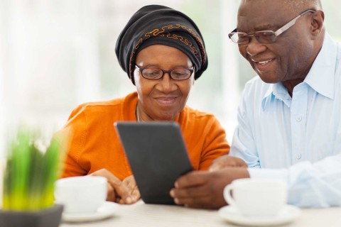 older couple looking at tablet