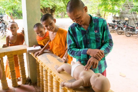 Cambodian Villagers and locals practicing first aid