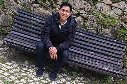 Oscar De Los Santos sitting on bench