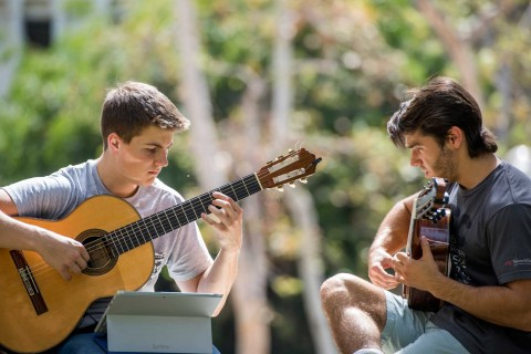 Thornton students playing guitar outside