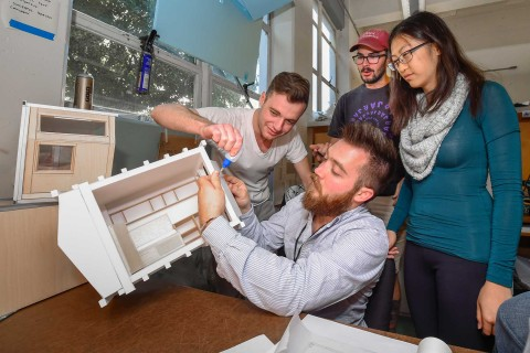 USC Architecture students working on model
