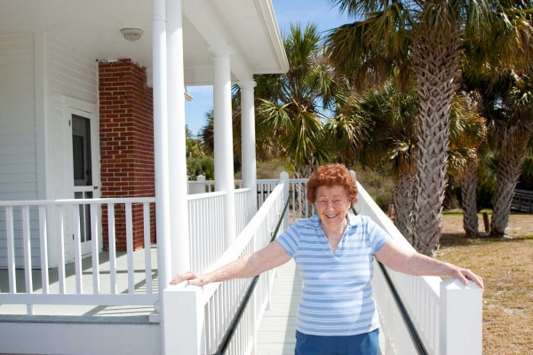 senior woman in front of home