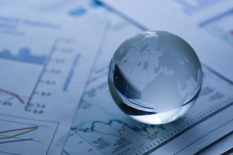 glass globe on business report
