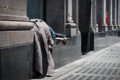 man sleeping on street