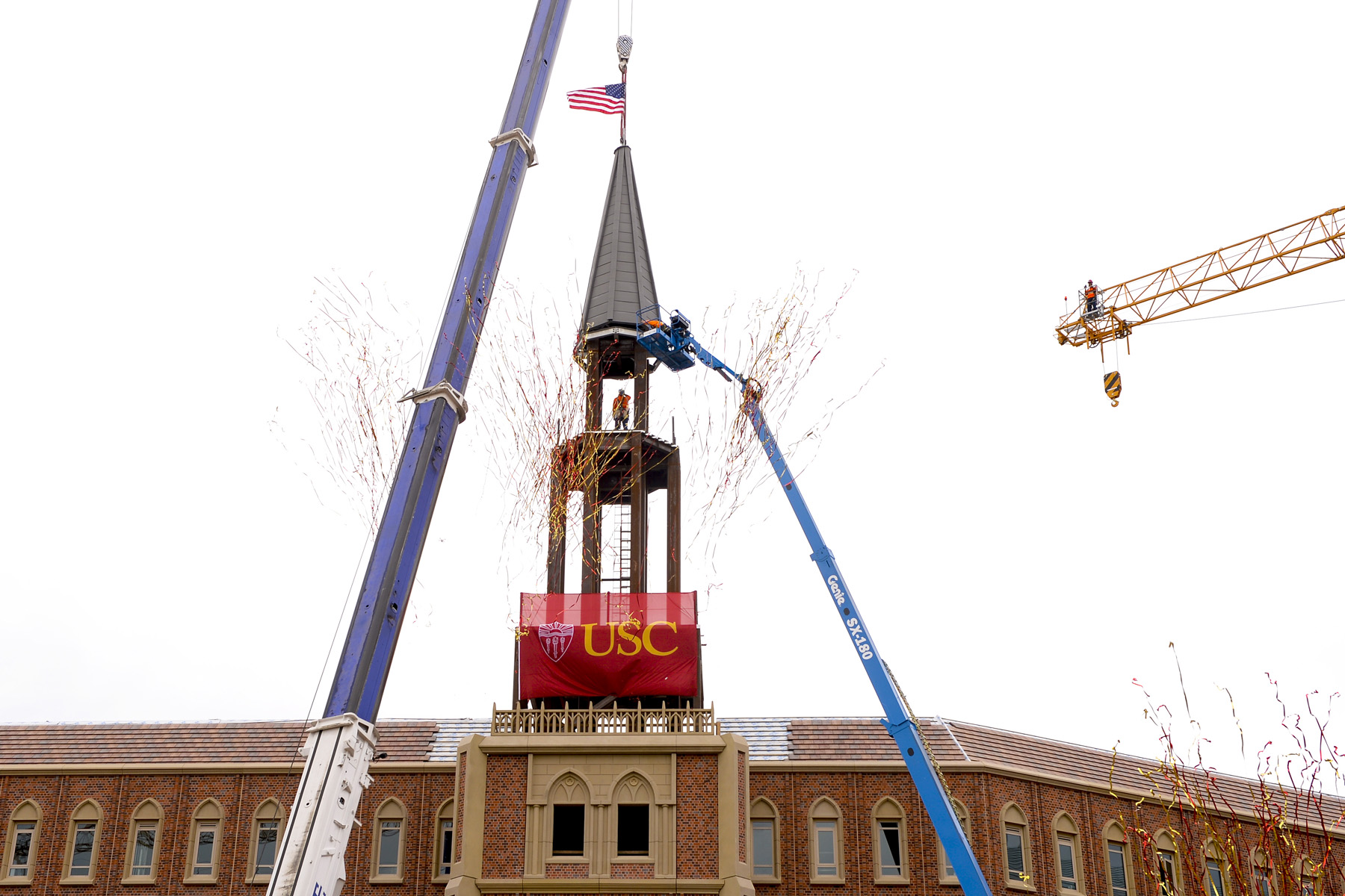 Spire being lowered at USC Village