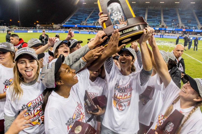 USC Women's soccer team with trophy