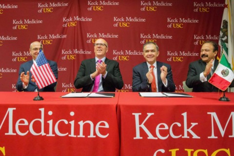signing agreement between Keck and Mexico City officials