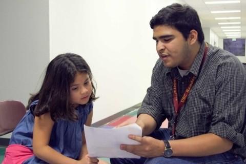 ReadersPlus volunteer coaching fifth grader