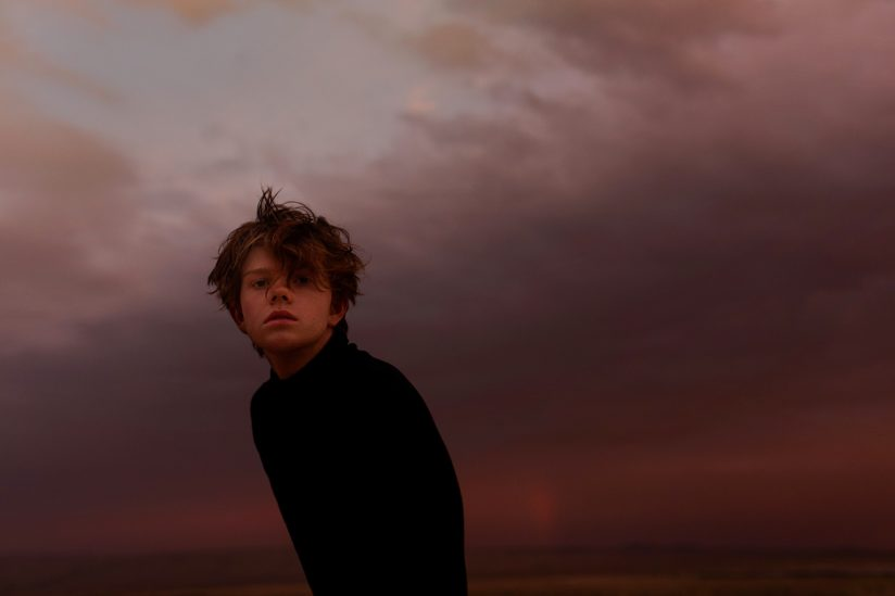 Alex Currie self portrait in front of dark sky