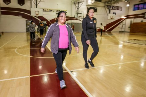 Fit Families walk around gym to exercise