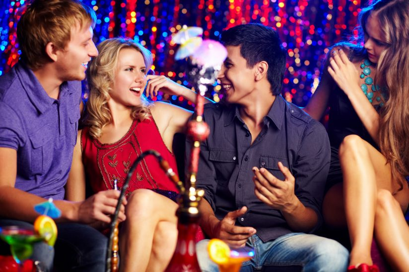 Young people in nightclub with hookah