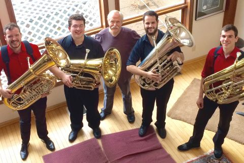 Tuba players pose for group photo