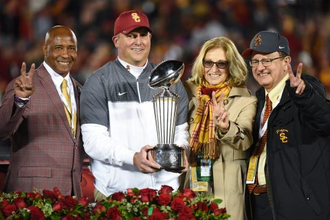 Lynn Swann, Clay Helton, Niki C. Nikias and C. L. Max Nikias with trophy