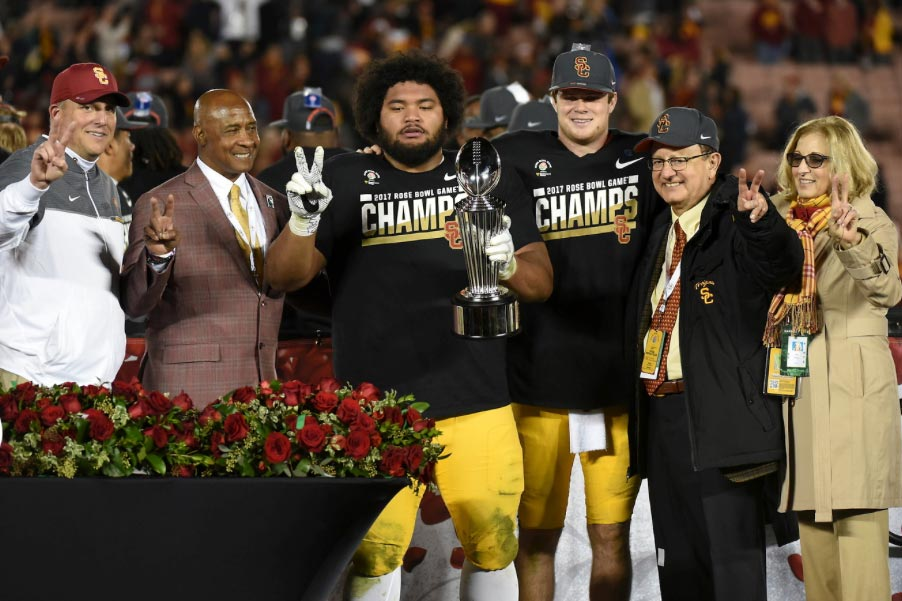 Clay Helton, Lynn Swann, Stevie Tu'ikolovatu, Sam Darnold, C. L. Max Nikias and Niki C. Nikias with Rose Bowl trophy