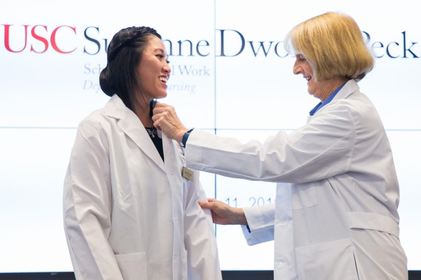 White coat ceremony student receives jacket from Sharon O'Neill