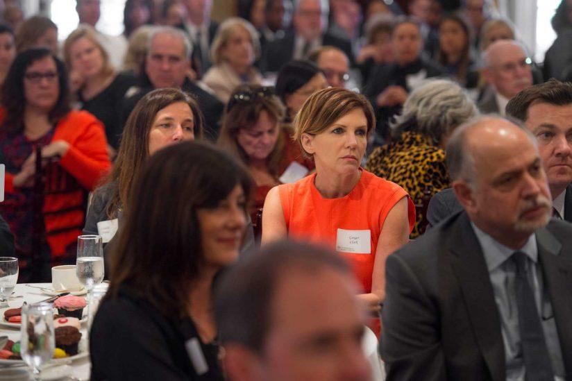 audience listens to speech