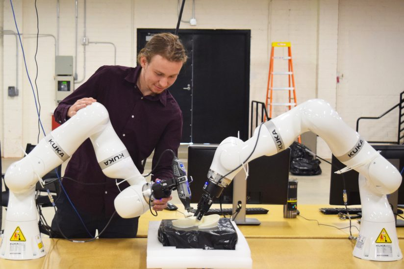 Engeineer working with robots