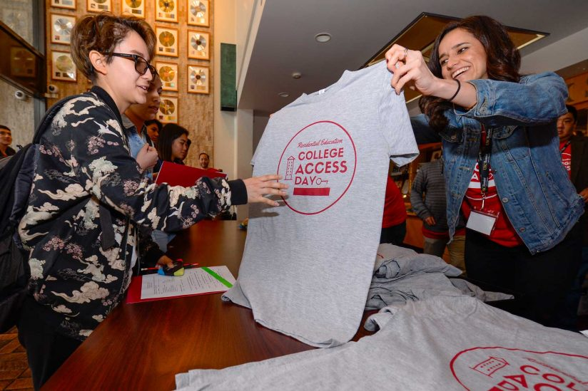 Students picking up College Access Day T-shirts