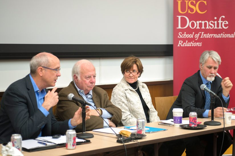 four experts speak at a panel