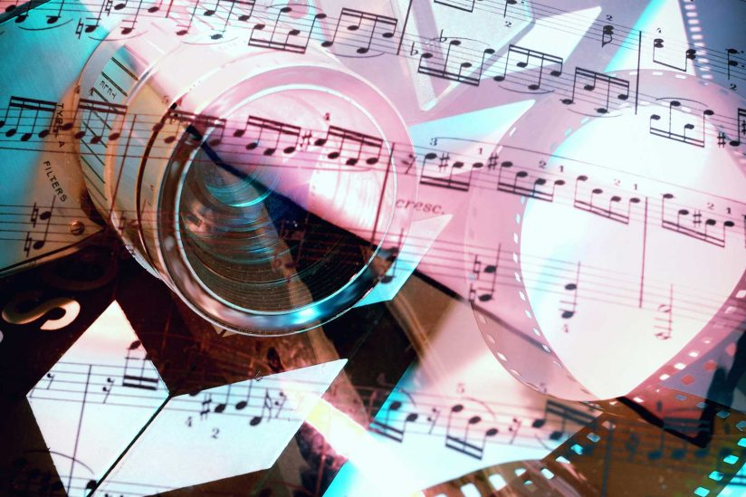 Sheet music with traditional film negatives overlaid in artistic illustration