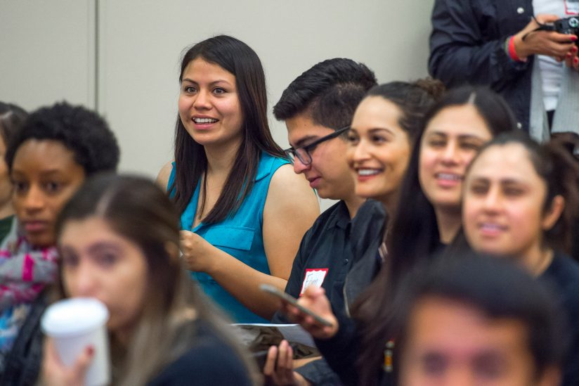 group of students in audience listening to speaker