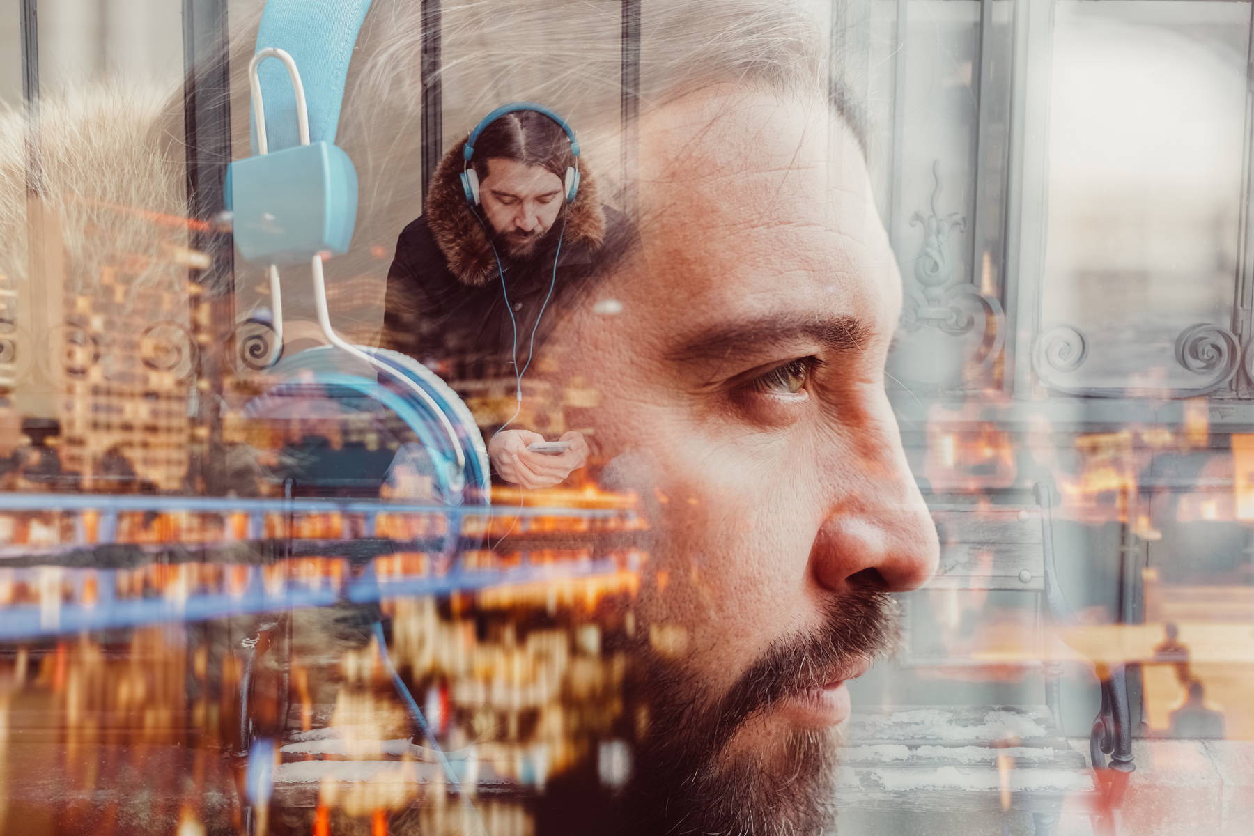 Multiple exposure of man with headphones