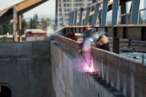Welder working on girders at Michelson