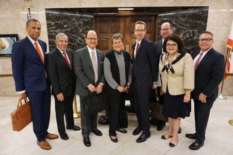 Posed group shot of President Nikias and trustees in Sacramento