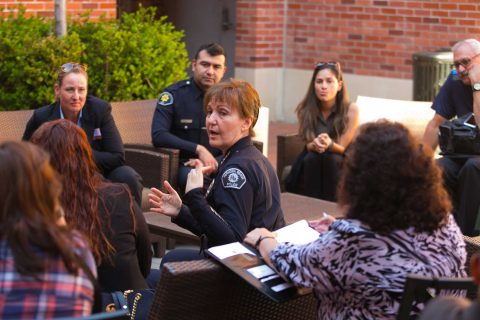 Police Chief Sharon Papa outside Tutor Center talking to a small group of people