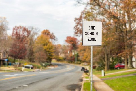 residentail neighborhood with sign showing boundary of school zone