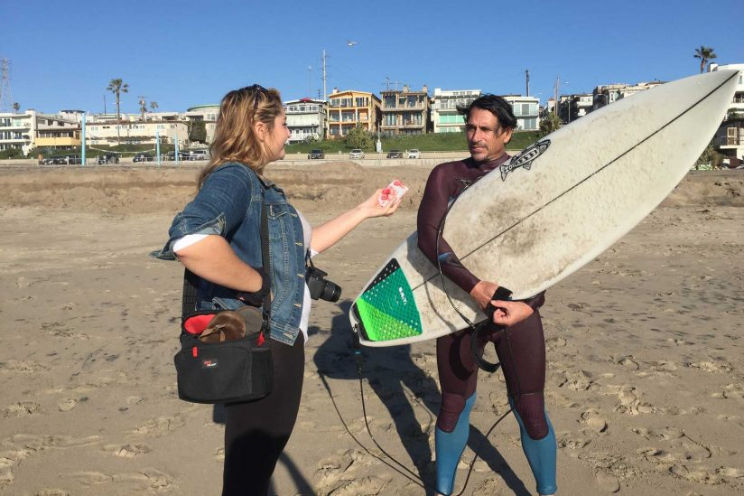 Journalism student interviewing surfer