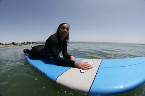 Soraya Simi portrait from gopro on surfboard