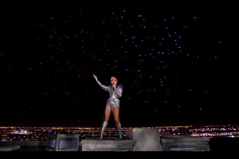 Lady Gaga with drones behind her at superbowl show